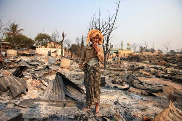 A Buddhist woman cries for her home that was burned down during the riot in Meikhtila